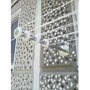 Бельевая сушилка с роликами стационарно закрепленными на трубе из полированной нержавеющей стали фото