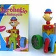 Детская деревянная игра-каталка фигурка на велосипеде фото