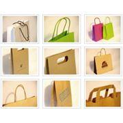 Пакеты бумажные с разными видами ручек фото