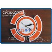 Изготовление часов в виде логотипа организации из акрила (25 х 25 см). фото