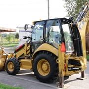 Фронтальный экскаватор-погрузчик на колесном ходу, марки Caterpillar 432 Е фото
