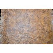 Кожзам обивочный коричневый фото