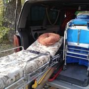 Помощь в перемещении лежачего больного фото