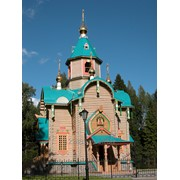 Церква с оцилиндрованного бревна фото