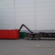 Аренда контейнера для мусора 20 м3 бесплатно и его вывоз гидролифтом MAN фото