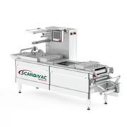 Автоматическая термоформовочная вакуум - упаковочная линия для колбасных изделий SCANDIVAC APM 2500 G фото