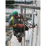 Работы ремонтно-строительные методом промышленного альпинизма фото