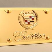 Декоративное покрытие золотом памятных табличек и эмблем фото