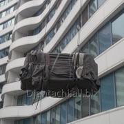 Услуги по спуску грузов из многоэтажных зданий фото