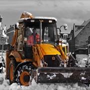 Вывоз снега в Киеве. Уборка снега. фото