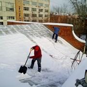 уборка снега и наледи с крыш. фото
