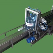 Автоматическая упаковочная машина в стрейч пленку фото