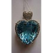 Голубой топаз огранка в форме сердца фото