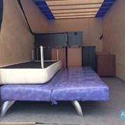Квартирный переезд мебельным фургоном. Грузчики. фото