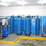 Монтаж и наладка водоочистного оборудования. Установка систем очистки воды. фото