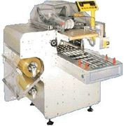 Оборудование для упаковки продуктов на подложку в пищевую стретч-пленку (стрейч) фото