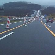 Краска для временной разметки дорог оранжевая фото