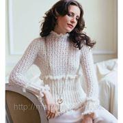 Вязаный белый свитер. фото