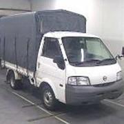 Легкий грузовик бортовой тент NISSAN VANETTE полный привод 4х4 грузопод 1 т пробег 143 т км фото
