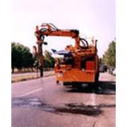 Машины для строительства покрытий автодорог фото
