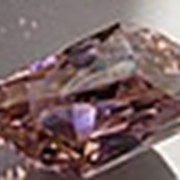 Розовый топаз эксклюзивной огранки фото