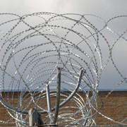Монтаж спиральных барьеров СББ Кобра в Казахстане фото