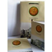 Папка, блокнот и бумажный пакет фото