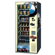 Cнэковые автоматы для продажи охлажденных напитков в банках и пластиковых бутылках, йогуртов, снэков и других продуктов в упаковке фото