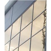 Облицовка нержавеющим листом, натуральным камнем, композитными материалами, тонированным стеклом фото