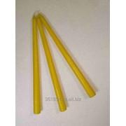 Свеча желтая конусная. фото