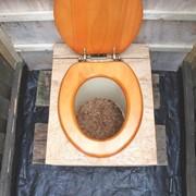 Откачка дачного туалета фото