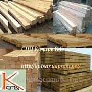 Деревянный мостовой брус. фото