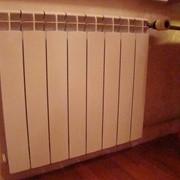 Установка радиаторов, батарей отопления. фото