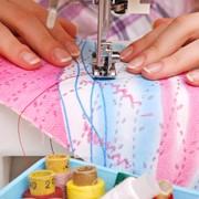 Массовый пошив женской одежды. фото