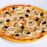 Пицца с морепродуктами. фото