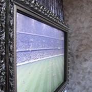 Оформление ТВ-зоны в багет фото
