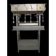 Аппарат для розлива сока в стеклянную бутылку фото