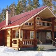 Дом из оцилиндрованного бревна и профилированного бруса фото