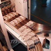 Оборудование для укладки одноразовых пакетов с чаем, кофе, сахаром и т.д. (изготовленных фасовочным автоматом) в коробки. фото