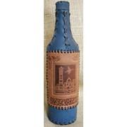 Бутылки декорированные кожей. фото