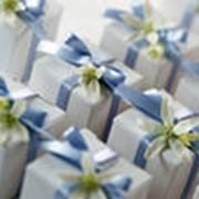 Ручная упаковка подарков и сувениров фото