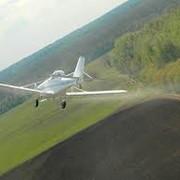 Услуги авиации по опылению урожая фото