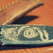 Лазерная гравировка на ножах фото