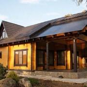 Дом деревянный из оцилиндрованного бруса, сруб фото