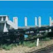 Вагон-платформа универсальная с несъемным оборудованием для перевозки листового проката модель 13-4012-14 фото