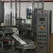 Трехрядное упаковочное оборудование для упаковки кисломолочных продуктов в стаканчики из полистирола или полипропилена фото