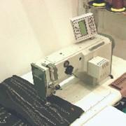 Промышленная компьютеризированная швейная машина фото