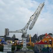 Бетонораспределительная гидравлическая стрела с бетоноводом 125 мм для распределения бетона на любой высоте по всей площади строительства. Стрела с функцией самоподъема. Техника строительная. фото