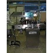 Термоусадочный автомат с одной головкой UNICAP 35, NORTAN, для нанесения и термоусадки колпачков. фото