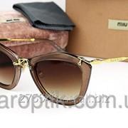 Женские солнцезащитные очки miu miu smu10ns Braun Gold фото